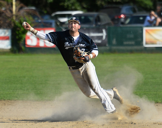 CARL RUSSO/Staff photo Manchester Essex Mariners, Caulin Rogers makes the out at second and the throw to first for the double play. The Rowley Rams defeated the Manchester Essex Mariners 6-2 in baseball action of game four of the ITL Finals.  8/17/2019