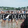 Beach goer's look on as a movement group takes to Good Harbor Beach Sunday afternoon to share their message. Desi Smith Photo/Gloucester Daily Times.