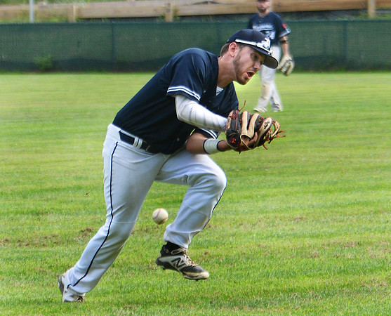 CARL RUSSO/Staff photo Manchester Essex Mariners, Eric Chalmers is under able to catch the pop fly for the out but recovered the ball and threw the runner out at second base. The Rowley Rams defeated the Manchester Essex Mariners 6-2 in baseball action of game four of the ITL Finals.  8/17/2019