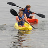 Jim Vaiknoras/Gloucester Daily Times. Isabella Britton, 9, and her brother Jackson, 11, visiting from Melrose explore Front Beach in Rockport on kayaks Thursday morning.
