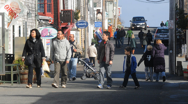 JIm Vaiknoras/Gloucester Daily Times. Shoppers stroll Bearskin Neck in Rockport Friday.
