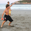 Jim Vaiknoras/Gloucester Daily Times:John Dyer makes a move on Andrew Mente while playing a game of touch football on Good Harbor Beach this past week. It was Andrew's 16th birthday and he wanted to play 2 on 2 football with his friends Nate and John Dyer and his dad Nathan Mente.