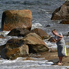 Jim Vaiknoras/Gloucester Daily Times: Griffin Barnes, 8, takes advantage of the warm weather to skip stones on Front Beach in Rockport Monday.