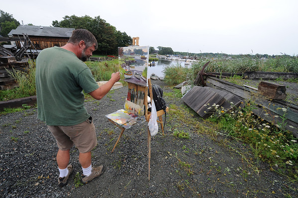 Essex:  Gloucester Artist Caleb Stone formerly of Rockport, paints a scene at the Essex Shipbuilders Museum at the First Annual Paint Essex Day and Wet Paint Auction Saturday morning. Artist from all over came to paint scenes in and around Essex, and where later shown and auctioned off at the barn at the Cox Reservation. Over 50 artist participated, all but two paintings sold by the end of the silent auction and reception. The money raised went to the Essex Merchants Group to help make Essex a destination spot from people to visit.   Desi Smith/Gloucester Daily Times. August 18, 2012