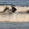 Gloucester: A surfer catches a wave off Good Harbor Beach in Gloucester Wednesday evening. Jim Vaiknoras /staff photo