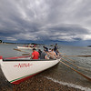 Gloucester: One of the crews racing in the Nina lands just ahead of it's opponent at the Seine boat eliminations on Pavilion Beach Wednesday night. Jim Vaiknoras/staff photo