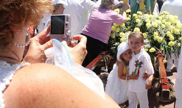 Siblings Jack and Charoltte Nicastro, 4 and 3 respectively, pose in front of the Statue of St. Peter before the start of the Fiesta parade in July. Photo by Maria Uminski/Gloucester Daily Times