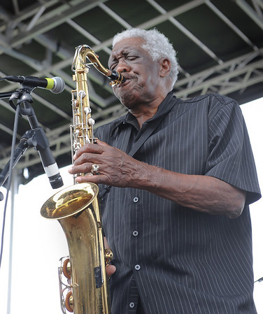 Gloucester:  Eddie Shaw of Eddie Shaw and the Wolfgand plays his sax at the First Gloucester Blues Festival, on outdoor stage at Stage Fort Park  Saturday afternoon, alond with his Eddie Vaan Shaw and long time bassist Shorty Gilbert.  Desi Smith/Gloucester Daily Times. August 11,2012