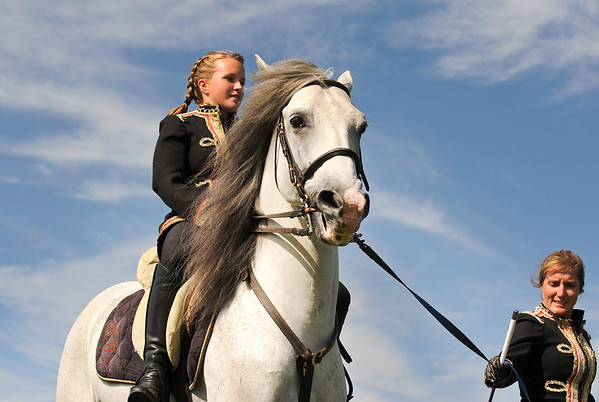 Essex: A young rider with the Royal Lipizzan is lead around inside a ring, as she performs some maneuvers on her stallion for a crowd of spectators Saturday afternoon at Cogswell's Grant.   Desi Smith/Gloucester Daily Times. September 9, 2012