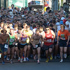 Gloucester:  Around 500 runners take off at the start of the Annual St. Peter's Fiesta 5k Road Race Thursday evening.  Desi Smith/Gloucester Daily Times. June 28,2012