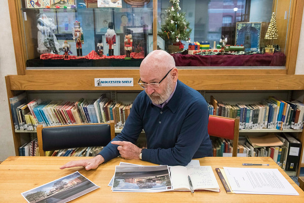 SAM GORESH/Staff photo. Peter Feinstein, chairman of the Sawyer Free Library's building committee discusses the library's plans for a new wing. 12/5/16