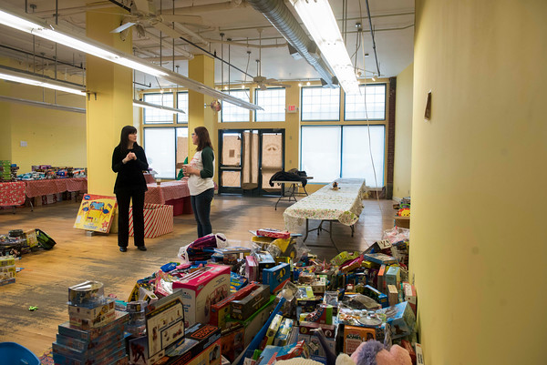 SAM GORESH/Staff photo. Action Inc. executive director Peggy Hegarty-Steck (left) and project coordinator Megan Merlin (right) discuss their annual toy drive. Parents will have a chance to pick out toys for their children during 15 minute appointments at the former Common Crow Store. 12/8/16