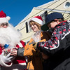 SAM GORESH/Staff photo. Santa gives bags of goodies to brothers Riley, 10, and Flynn, 8, Blanchard in Rockport's Dock Square. 12/25/16