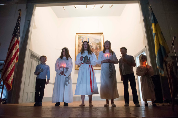 SAM GORESH/Staff photo. From left: Dean Rask, 7, Harleigh Johnson, 10, Bethany Willcox, 15, Erica Rask, 13 Karl Rask, 11, and Lucy Willcox, 6, sing in the Santa Lucia Pagent at Jul Fest at Spiran Hall in Rockport. 12/10/16