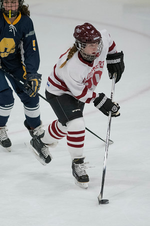 SAM GORESH/Staff photo. Gloucester sophomore Maisie Grow takes control of the puck in their game against Andover at Dorothy Talbot Rink. 12/21/16