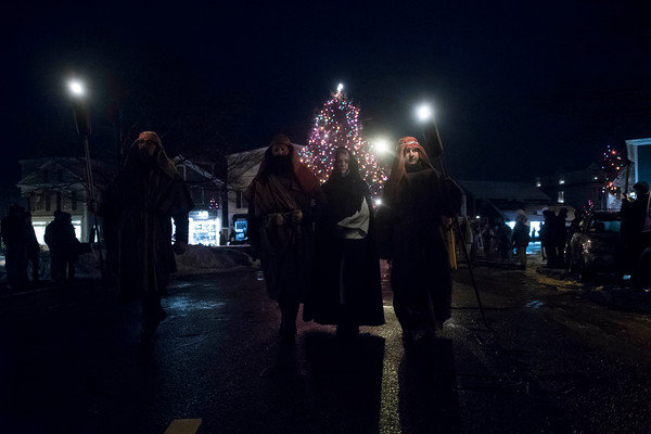 SAM GORESH/Staff photo. Jim Koerth (center, left) as Joseph and Catherine Nichols (center, right) walk down Main street during the 71st Annual Rockport Christmas Pageant. 12/17/16
