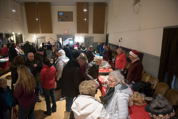 SAM GORESH/Staff photo. People browse baked goods and gifts at the market at Jul Fest at Spiran Hall in Rockport. 12/10/16