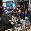 "SAM GORESH/Staff photo. Toad Hall bookstore employee Nancy Sullivan (left) rights up customer Patricia Weisberg's purchases. Weisburg came to the bookstore from Gloucester looking for local author Gunilla Caulfield's novel, ""Murder in Pigeon Cove."" 12/8/16"