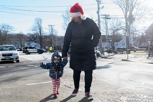 SAM GORESH/Staff photo. Stephanie Fitzgerald and her son Wesley Fitzgerald, 1, line up to meet Santa in Rockport's Dock Square. 12/25/16