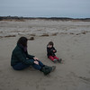 SAM GORESH/Staff photo. Clifton Heischman, 3, (right) talks to his mother Jennifer Heischman (left) as they play in the last moments of daylight on Good Harbor Beach. 12/13/16