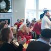 SAM GORESH/Staff photo. The crowd applauds after Gloucester mayor Sefatia Romeo Theken speaks at the Discover Gloucester Awards at the Cruiseport Gloucester ballroom. 12/5/16