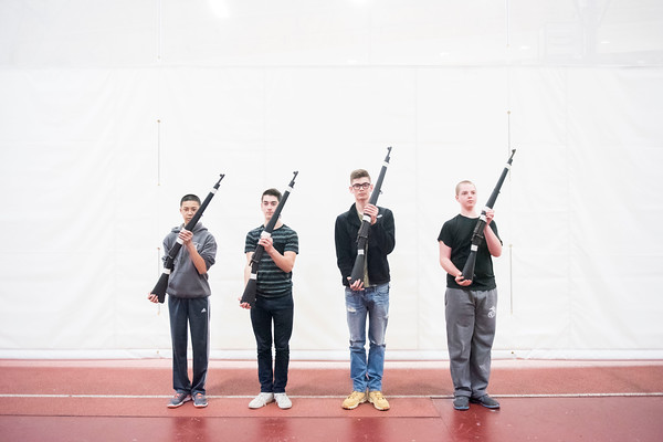 SAM GORESH/Staff photo. From left: sophomore Jack Ho, sophomore Evan Sawyer, junior Arthur Vargas and sophomore Steven Brown, members of Gloucester High School's JRROTC drill team pose for a portrait with their rifles after winning the armed events in the Northeast Regional championships and earning a spot in the JROTC nationals in April in Irving Texas. 12/13/16