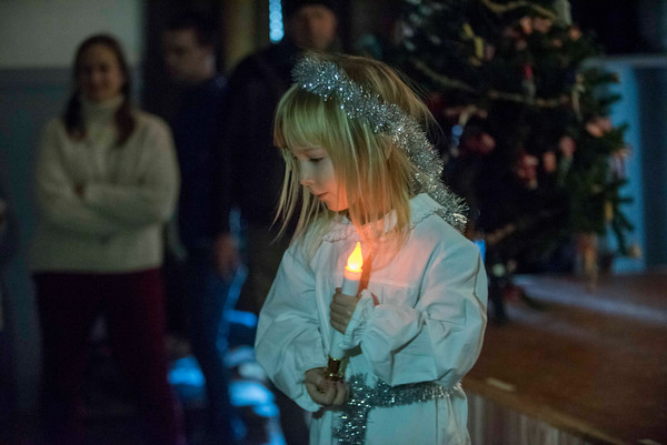 SAM GORESH/Staff photo. Lucy Wilcox, 6, walks off the stage after performing in the Santa Lucia Pageant at Jul Fest at Spiran Hall in Rockport. 12/10/16