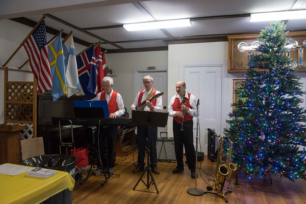 SAM GORESH/Staff photo. For left: Dan Murphy, Mark French, and Bob Landoni play music at Jul Fest at Spiran Hall in Rockport. 12/10/16