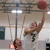 SAM GORESH/Staff photo. Manchester-Essex senior Spencer Feuerbach shoots the ball over Rockport junior Quinn Murdock in their game at Manchester-Essex. 12/23/16