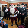 SAM GORESH/Staff photo. Santa Claus joins a group of firefighters and paramedics sing Christmas carols to residents at the Golden Living Center. 12/22/16