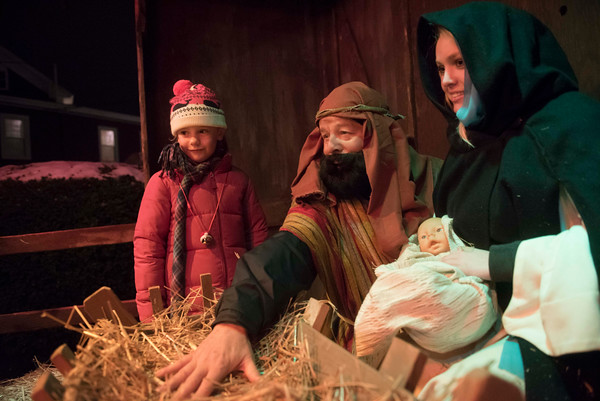 SAM GORESH/Staff photo. From left: Delaney Clements, 5,  visits with Jim Koerth as Joseph and Catherine Nichols as Mary after the 71st Annual Rockport Christmas Pageant. 12/17/16