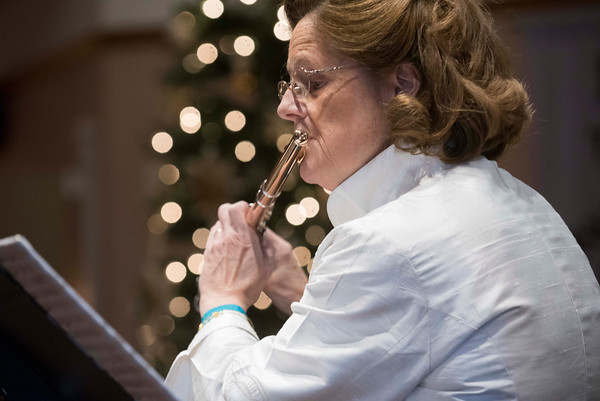 SAM GORESH/Staff photo. Jeannine Lynch plays the flute in a classical concert at the Trinity Congregational Church during the Middle Street Walk. 12/10/16