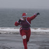 SAM GORESH/Staff photo. Osha Saylor  of Gloucester cheers as she reaches the finish line at the Seaside Santa race. 12/17/16