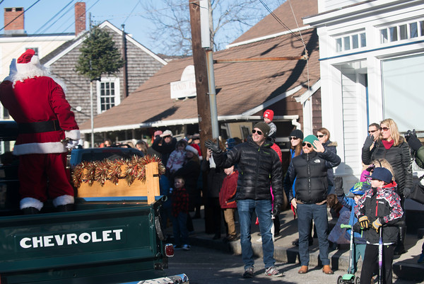 SAM GORESH/Staff photo. The crowd greets Santa as he arrives in Rockport's Dock Square. 12/25/16