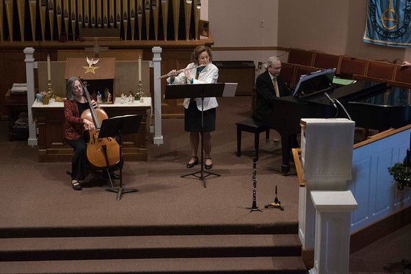 SAM GORESH/Staff photo. From left: Mary Jane Febonio, Jeannine Lynch, and Louis Stella play a classical concert at the Trinity Congregational Church during the Middle Street Walk. 12/10/16