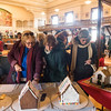 SAM GORESH/Staff photo. From left: Anne Connaughton, Kathy O'Neill and Mary Malagodi admire the gingerbread houses on display in City Hall's Kyrouz Auditorium during the Middle Street Walk. 12/10/16