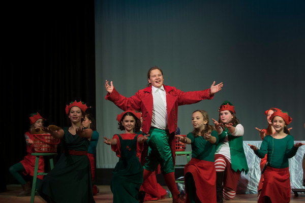 """SAM GORESH/Staff photo. Levin Rudler makes his entrance as Buddy the Elf in Rockport Middle School's production of """"Elf: The Musical,"""" which opens tonight at 7pm. 12/14/16"""