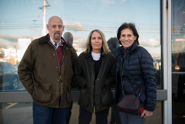 SAM GORESH/Staff photo. From left: Jeff Fox, his wife Caryl Fox, and friend Josie Gardner pose for a portrait outside of Gloucester Cinema after watching Manchester By the Sea. 12/3/16