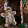 SAM GORESH/Staff photo. A gingerbread man at the entrance to a gingerbread house on display at City Hall's Kyrouz Auditorium during the Middle Street Walk. 12/10/16