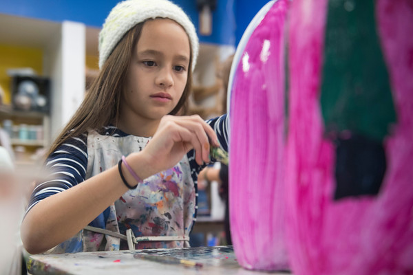 SAM GORESH/Staff photo. Abby Stauffer, 10, paints  a buoy for the lobster pot tree at the Cape Ann Art Haven, during the Middle Street Walk. 12/10/16
