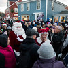 SAM GORESH/Staff photo. The crowd welcomes Santa and Mrs. Claus to the tree lighting ceremony at Rockport's Christmas celebration. 12/3/16