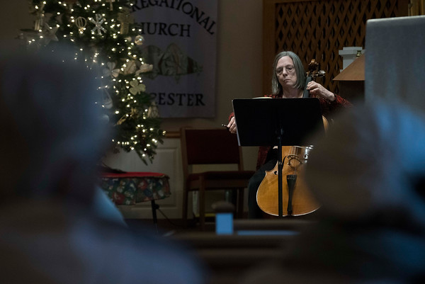 SAM GORESH/Staff photo. From left: Mary Jane Febonio plays the cello in a classical concert at the Trinity Congregational Church during the Middle Street Walk. 12/10/16
