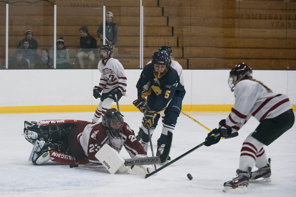 SAM GORESH/Staff photo. Gloucester goalie, Jenna Taormina dives to block a shot in their game against Andover at Dorothy Talbot Rink. 12/21/16