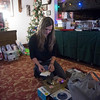 SAM GORESH/Staff photo. Wellspring House board member Allison Mueller labels gifts for teens that the firefighters brought to the Wellspring House as part of their annual toy drive. The Wellspring House offers families in need the chance to shop for toys donated by locals. For the past four years firefighter Dean DeCoste has helped fundraise and shop for toys. He said that between a GoFundMe page and firefighters collecting donations outside of  Stop and Shop they raised over $3,000 and used it to get gifts for teens. Mueller said that this year they have about 110 teens who need gifts, which is more than they have had before. 12/8/16