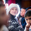 SAM GORESH/Staff photo. Veterans' Memorial Elementary School first grader Nicholai Slocuum sings with his classmates during the school's Holiday Sing-a-Long . 12/15/16