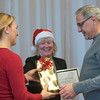 SAM GORESH/Staff photo. From left: Discover Gloucester vice chair Tobin Dominick and executive director Elizabeth Carey present the Good on Ya Award to Barry Pett of the Gloucester Fireworks Committee during the Discover Gloucester Awards at the Cruiseport Gloucester ballroom. 12/5/16