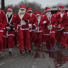 SAM GORESH/Staff photo. Runners take off from the start line at the Seaside Santa race. 12/17/16