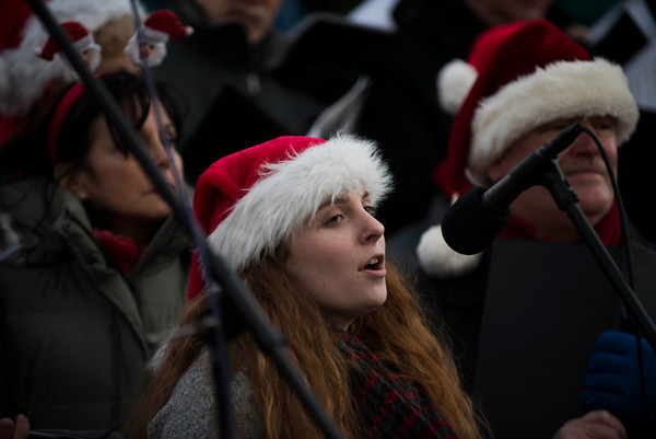 """SAM GORESH/Staff photo. Chloe Beaulieu sings a solo during """"Christmas in Rockport,"""" a song written by resident Dorothy Ramsey Staffa before the tree lighting at Rockport's Christmas celebration. 12/3/16"""