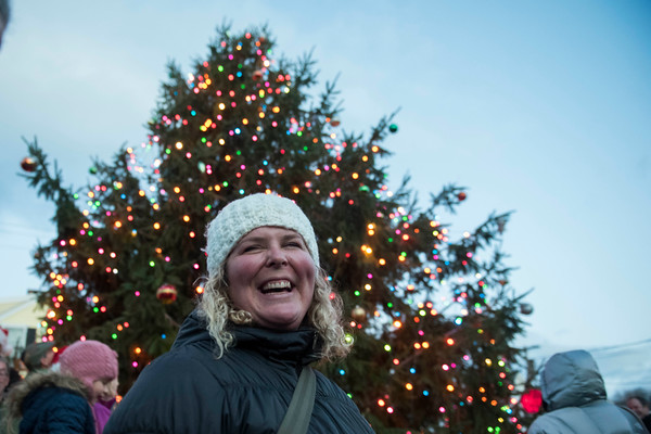 SAM GORESH/Staff photo. Rockport resident Molly Johnson smiles after lighting the town's Christmas tree which she had planted almost 30 years ago after receiving it for Arbor Day when she was in kindergarten at Pigeon Cove Elementary School during Rockport's Christmas celebration. 12/3/16