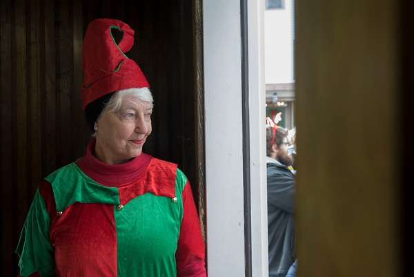 SAM GORESH/Staff photo. Margaret Williams waits to welcome families into the Old Firehouse for photos with Santa and Mrs. Claus during Rockport's Christmas celebration. 12/3/16